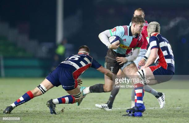 Henry Cheeseman of Harlequins A escapes the challenge of Dan Thurston of Bristol United during the Aviva A League match between Harlequins A and...