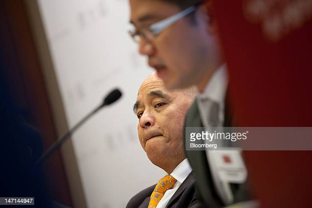 Henry Cheng chairman of Chow Tai Fook Jewellery Group Ltd left reacts during a news conference in Hong Kong China on Tuesday June 26 2012 Chow Tai...