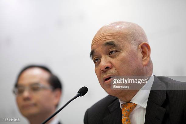Henry Cheng chairman of Chow Tai Fook Jewellery Group Ltd right speaks during a news conference in Hong Kong China on Tuesday June 26 2012 Chow Tai...