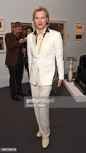 Henry Conway attends a private view of 'Bowie/Collector' the personal art collection of David Bowie at Sotheby's on November 1 2016 in London England