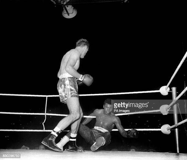 Henry Cooper knocks down Cassius Clay during the fourth round