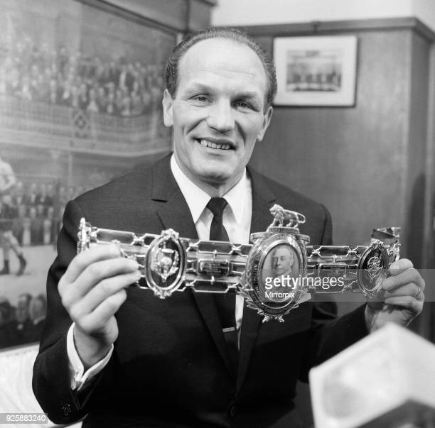 Henry Cooper, proudly shows off his 3rd Lonsdale bet, which was presented to him by Sir Onslow Fane at the Boxing Board of Control offices, London,...