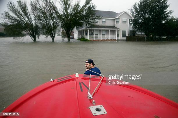 Henry Cox pulls his boat through deep water while rescuing residents from the flood waters of Hurricane Isaac in the River Forest subdivision on...