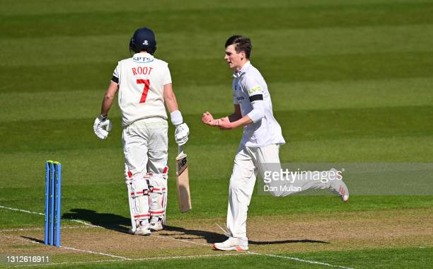 Henry Crocombe of Sussex celebrates taking the wicket of Billy Root of Glamorgan during day one of the LV= County Championship match between...