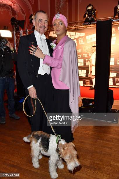 Henry de Winter with his dog Bobby and Julian F M Stoeckel arrive at the 'Night Of The Dead Stars' Masquerade Ball at Schloss Marquardt on November...