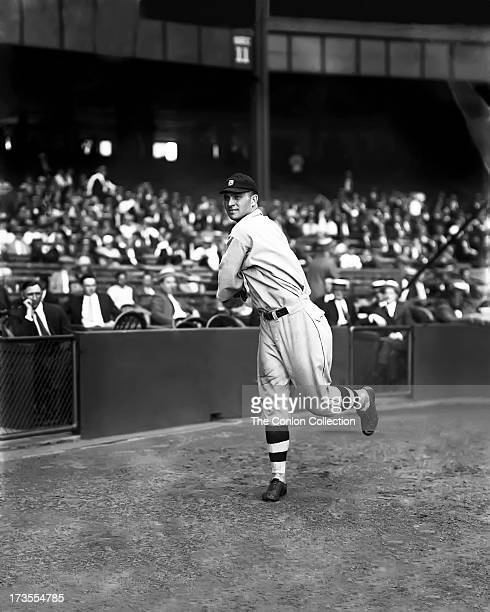 Henry E Manush of the Detroit Tigers throwing a ball in 1924