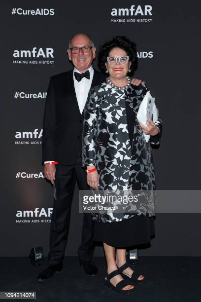 Henry Ehrhardt and Ester Vina pose during the amfAR gala dinner at the house of collector and museum patron Eugenio López on February 5 2019 in...