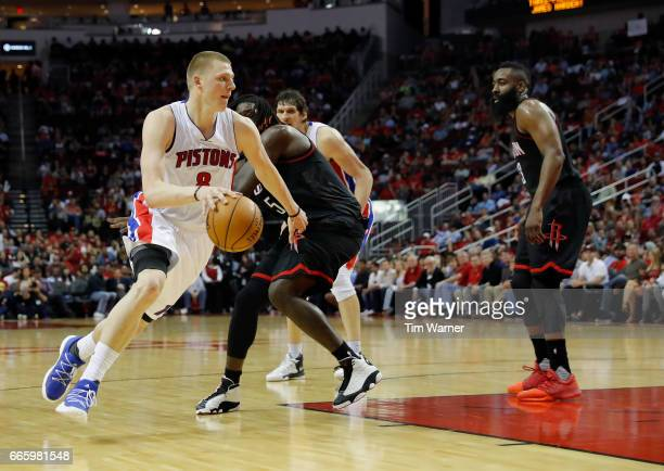 Henry Ellenson of the Detroit Pistons drives to the basket defended by Montrezl Harrell of the Houston Rockets in the second half at Toyota Center on...