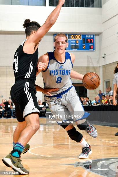 Henry Ellenson of the Detroit Pistons drives to the basket during the game against the Charlotte Hornets during the 2017 Orlando Summer League on...