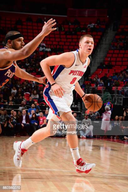 Henry Ellenson of the Detroit Pistons handles the ball against the Phoenix Suns on November 29 2017 at Little Caesars Arena in Detroit Michigan NOTE...