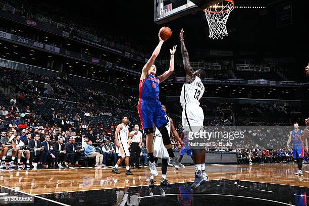 Henry Ellenson of the Detroit Pistons shoots against Anthony Bennett of the Brooklyn Nets on October 6 2016 at Barclays Center in the Brooklyn...
