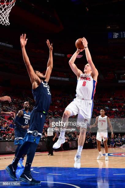 Henry Ellenson of the Detroit Pistons shoots the ball against the Minnesota Timberwolves on October 25 2017 at Little Caesars Arena in Detroit...