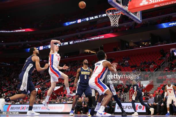 Henry Ellenson of the Detroit Pistons shoots the ball during the game against the Denver Nuggets at Little Caesars Arena on December 12 2017 in...