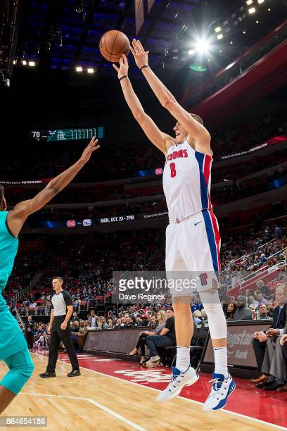 Henry Ellenson of the Detroit Pistons takes a jump shot from the corner against the Charlotte Hornets during the Inaugural NBA game at the new Little...