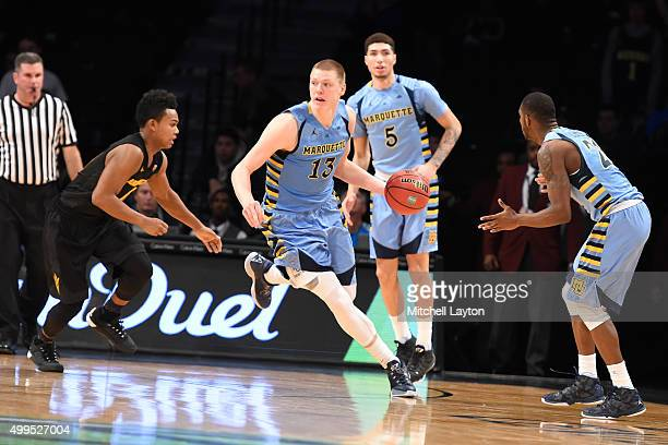 Henry Ellenson of the Marquette Golden Eagles dribbles up court during the championship game of the Legends Classic college basketball tournament at...