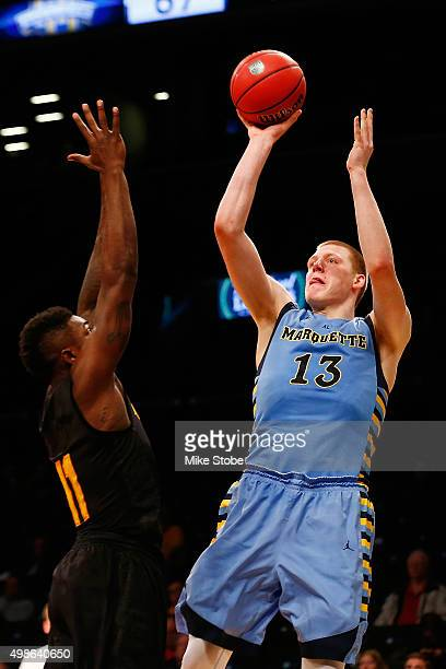 Henry Ellenson of the Marquette Golden Eagles hits a basket against the Arizona State Sun Devils at Barclays Center on November 24 2015 in Brooklyn...