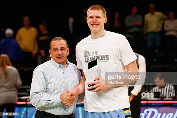 Henry Ellenson of the Marquette Golden Eagles poses for a photo with the MVP trophy after defeating the Arizona State Sun Devils at Barclays Center...
