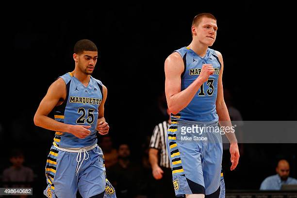 Henry Ellenson of the Marquette Golden Eagles pups his fist against the Arizona State Sun Devils at Barclays Center on November 24 2015 in Brooklyn...