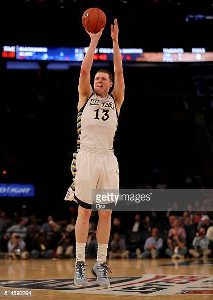Henry Ellenson of the Marquette Golden Eagles shoots a three point shot in the second half against the St John's Red Storm during the Big East...