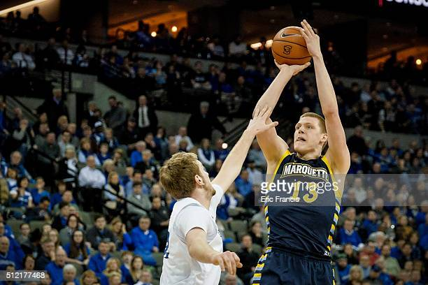 Henry Ellenson of the Marquette Golden Eagles shoots the ball over Toby Hegner of the Creighton Bluejays during their game at CenturyLink Center on...