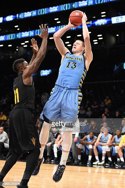 Henry Ellenson of the Marquette Golden Eagles takes a jumpshot during the championship game of the Legends Classic college basketball tournament at...