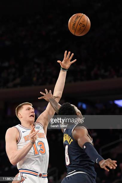 Henry Ellenson of the New York Knicks attempts a basket against Jarred Vanderbilt of the Denver Nuggets during the second half of the game at Madison...