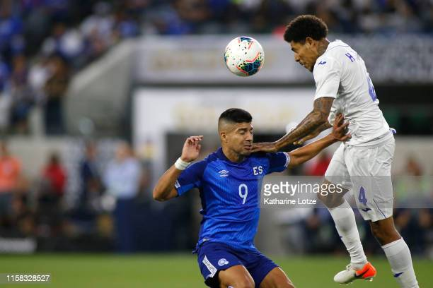 Henry Figueroa of Honduras and Nelson Bonilla of El Salvador go in for a header during the first half of Honduras v El Salvador Group C 2019 CONCACAF...