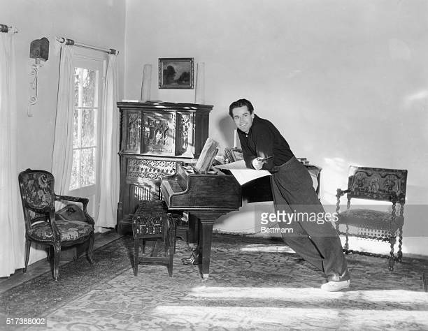 Henry Fonda in a corner of the livingroom of his suburban home in the Westwood district of Los Angeles Undated photograph Publicity still