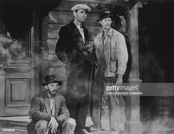 Henry Fonda John Carradine and John Qualen in a scene from John Ford's screen version of John Steinbeck's Pulitzer Prizewinning novel 'The Grapes of...