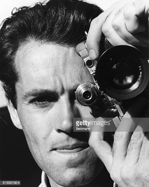 Henry Fonda poses with his cameraHe is an amateur photographer who has his own darkroom and develops all of his own picturesUndated photograph