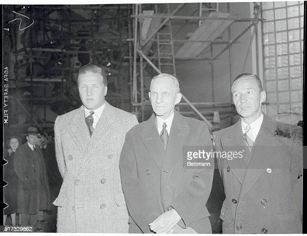 Henry Ford, 2nd left, is shown with his grandfather, Henry Ford Sr., motor magnate, center, and his father, Edsel Ford, right, as the Ford exhibit...