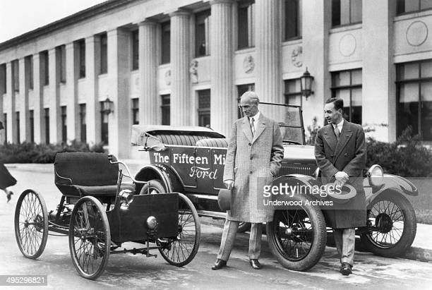 Henry Ford and Edsel Ford with the original 1896 Quadricycle and the 15th millionth Ford Model T Detroit Michigan 1927