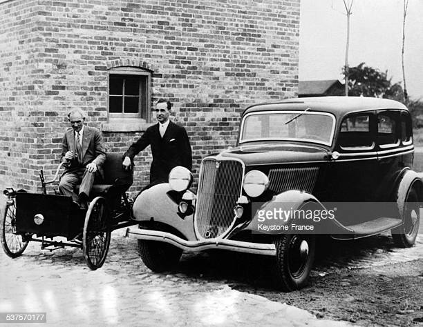 Henry Ford and his son Edsel seat on the first Ford released from the factory Thirties ago, on July 1, 1933 in the United States.
