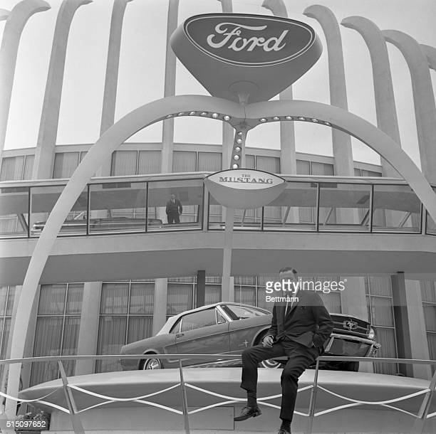 Henry Ford II outside For4d Motor Co Pavilion at New York World's Fair with unveiled model of Ford Mustang