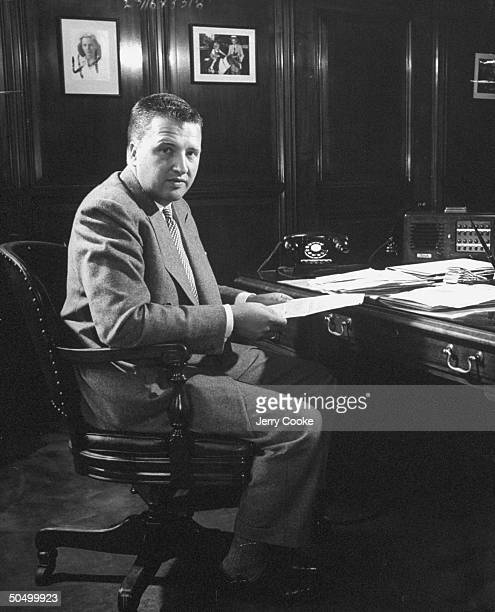 Henry Ford II sitting at his desk