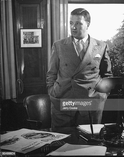 Henry Ford II standing at his desk
