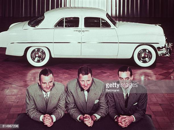 1950 Henry Ford II with brothers Benson and William Clay posed in front of 1950 automobile