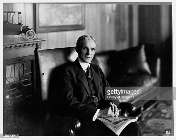 Henry Ford Sitting in Armchair with Magazine