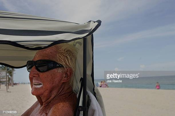 Henry Fraser wears zinc oxide on his lips as he sits in the shade during a visit to the beach June 20 2006 in Fort Lauderdale Florida Recent studies...