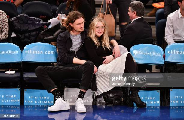 Henry Frye and Dakota Fanning attend the New York Knicks vs Milwaukee Bucks game at Madison Square Garden on February 6 2018 in New York City