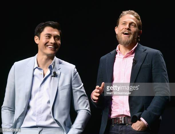 Henry Golding and Charlie Hunnam speak onstage at CinemaCon 2019 The State of the Industry and STXfilms Presentation at The Colosseum at Caesars...