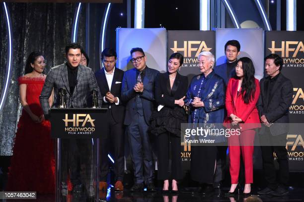Henry Golding and Constance Wu, Jimmy O. Yang, Ronny Chieng, Nico Santos, Michelle Yeoh, Lisa Lu, Harry Shum Jr., Awkwafina, and Ken Jeong accept the...