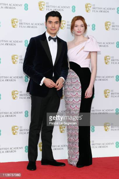 Henry Golding and Eleanor Tomlinson pose in the press room during the EE British Academy Film Awards at Royal Albert Hall on February 10 2019 in...