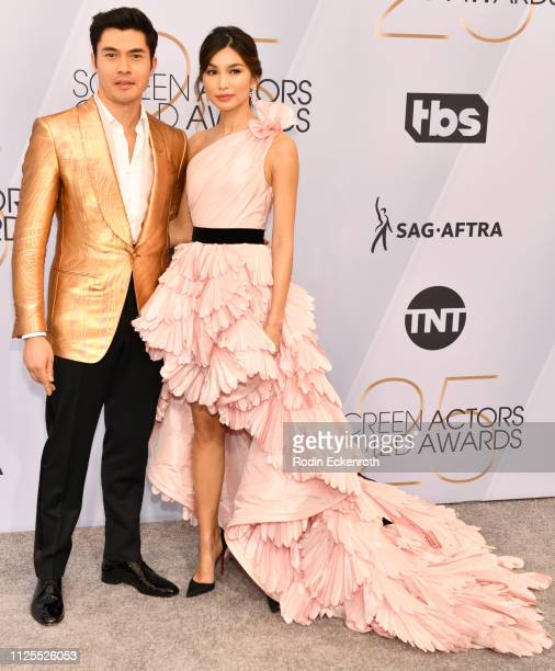 Henry Golding and Liv Lo arrive at the 25th Annual Screen Actors Guild Awards at The Shrine Auditorium on January 27 2019 in Los Angeles California