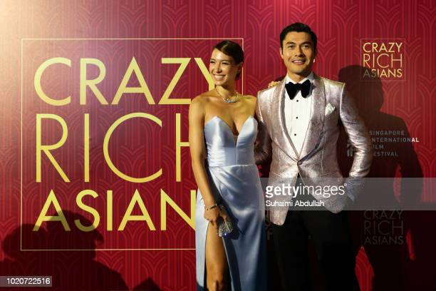 Henry Golding and wife Liv Lo attend the Singapore premiere of 'Crazy Rich Asians' on August 21 2018 in Singapore