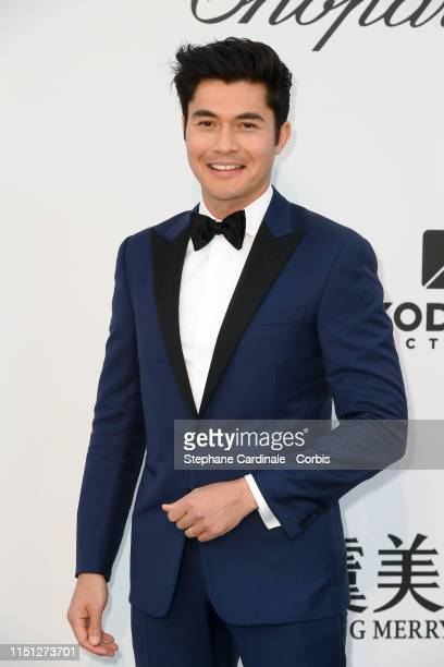 Henry Golding attends the amfAR Cannes Gala 2019>> at Hotel du CapEdenRoc on May 23 2019 in Cap d'Antibes France