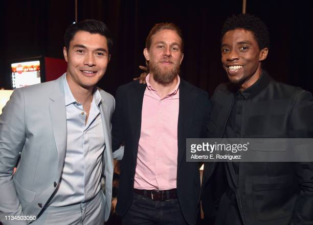 Henry Golding Charlie Hunnam and Chadwick Boseman pose backstage at CinemaCon 2019 The State of the Industry and STXfilms Presentation at The...
