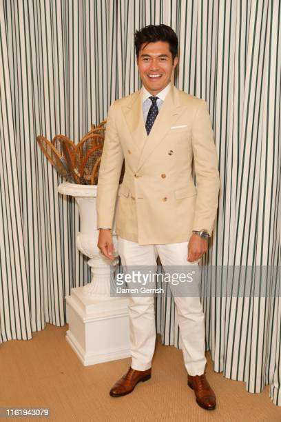 Henry Golding in Ralph Lauren Purple Label attends the Polo Ralph Lauren suite during the Wimbledon Tennis Championship Men's Final at All England...