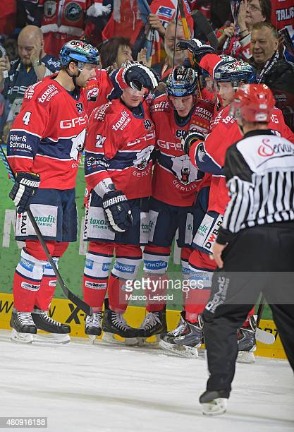 Henry Haase, Antti Miettinen, T.J. Mulock and Frank Hoerdler of the Eisbaeren Berlin celebrate after scoring the 1:2 during the game between...