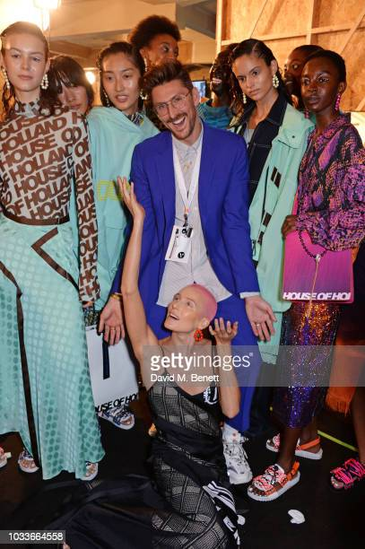 Henry Holland and Dree Hemingway pose with models backstage at the House Of Holland front row during London Fashion Week September 2018 at the My...